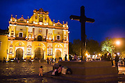 People gather at night on the public square in front of the cathedral in San Cristobal de las Casas, Chiapas, Mexico on June 24, 2008.