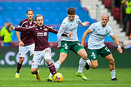 Barrie McKay (#18) of Heart of Midlothian FC tackles Kevin Nisbet (#15) of Hibernian FC during the Cinch SPFL Premiership match between Heart of Midlothian and Hibernian at Tynecastle Park, Edinburgh, Scotland on 12 September 2021.