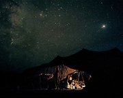 Under a starry night, the tent of a nomadic Baluch family. They are sheep and goat herders.<br /> Travelling over 4000km by train across Iran. An opportunity to enjoy Persian hospitality, discover Iran's ancient cities and its varied landscapes, from deserts to mountains.