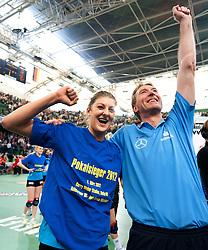 04-03-2012 VOLLEYBAL: FINAL DVV POKAL SCHWERINER SC - ROTE RABEN VILSBIBURG: HALLE<br /> Vreugde bij Anne Buijs en vader Teun Buijs (Trainer Schweriner SC) na de 3-1 overwinning<br /> ©2012-FotoHoogendoorn.nl/Conny Kurth