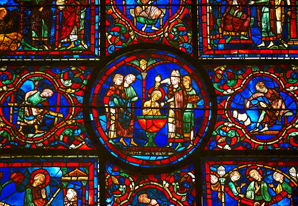 Medieval Windows of the Gothic Cathedral of Chartres, France, dedicated to St Martin of Tour.    A UNESCO World Heritage Site. In the  central oval panel St Martin is being baptised. .<br /> <br /> Visit our MEDIEVAL ART PHOTO COLLECTIONS for more   photos  to download or buy as prints https://funkystock.photoshelter.com/gallery-collection/Medieval-Middle-Ages-Art-Artefacts-Antiquities-Pictures-Images-of/C0000YpKXiAHnG2k