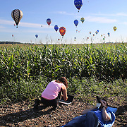 Support crew check wind speed and direction around rural Michigan near Battle Creek during the World Hot Air Ballooning Championships. Battle Creek, Michigan, USA. 18th August 2012. Photo Tim Clayton