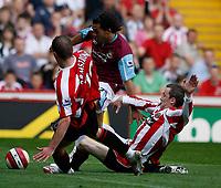 Photo: Paul Greenwood.<br />Sheffield United v West Ham United. The Barclays Premiership. 14/04/2007.<br />West Ham's Carlos Tevez (C) evades the challenge fo Derek Geary