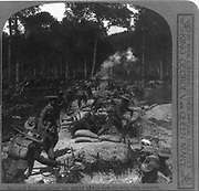 Second line coming up amid shell fire to win the trench   British soldiers in World War I. C1916