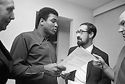 Muhammad Ali In Ireland..1972..14.07.1972..07.14.1972..14th July 1972..A short film on Muhammad Ali in Ireland has been made for showing in the USA before his bout with Al 'Blue'Lewis.The film sponsored by Bord Failte is produced and directed by Mr Louis Marcus.Commentary is provided by Muhammad Ali himself.The project was discussed at Oppermans Country Club Hotel,Kilternan,Co Dublin,where the Ali camp was based...Picture taken as Muhammad Ali goes over his lines with the Director, Mr Louis Marcus.Also in the picture are Mr Tom Sheehy,Bord Failte and sound recordist Mr Peter Hunt.