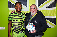 Matchball sponsor KB Coaches with man of the match Forest Green Rovers Ebou Adams(14) during the EFL Sky Bet League 2 match between Forest Green Rovers and Port Vale at the New Lawn, Forest Green, United Kingdom on 11 February 2020