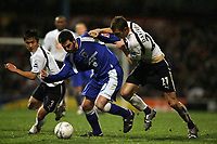 Photo: Rich Eaton.<br /> <br /> Cardiff City v Tottenham Hotspur. The FA Cup. 07/01/2007. Steve Thompson centre of Cardiff is flanked by Young-Po Lee (left) and Calum Davenport (right) of Spurs