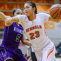 Gallup Bengal Sara Ann Shirley (23) rushes past Miyamura Patriot Hannah Murphy (5) Monday at Gallup High School.