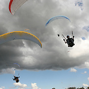 149 of the World's best paragliding pilots from 39 nations descended on the small country town of Manilla near Tamworth in northern New South Wales, Australia to contest the 10th FAI Paragliding World Championships during March 2007. The drought stricken area is renowned for it's great cross country flying from the Mount Borah hillside and over two hectic weeks, numerous incidents and mixed weather, the pilots were able to fly five tasks to decide the winners in what proved to be an extremely close contest.. The Men's competition was won by Great British pilot Bruce Goldsmith with Jean-Marc Caron of France finishing second just seventeen points behind with Thomas Mccune of USA finishing third. The women's competition was won by Petra Slivova of Czech Republic with Viv Williams of Australian just fifteen points behind and New Zealand pilot Harmony Gaw finishing third. .In the team event Czech Republic finished first followed by France and Switzerland...Pilots land after completing a task..
