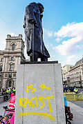 Extinction Rebellion protesters spray graffiti onto the plinth of the Winston Churchill statue in Parliament Square, central London on Thursday, Sept 10, 2020. Environmental nonviolent activists group Extinction Rebellion enters its 10th and final day of continuous ten days protests to disrupt political institutions throughout peaceful actions swarming central London into a standoff, demanding that central government obeys and delivers Climate Emergency bill. (VXP Photo/ Vudi Xhymshiti)
