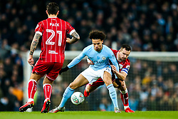 Leroy Sane of Manchester City is challenged by Bailey Wright of Bristol City - Rogan/JMP - 09/01/2018 - Etihad Stadium - Manchester, England - Manchester City v Bristol City - Carabao Cup Semi Final First Leg.