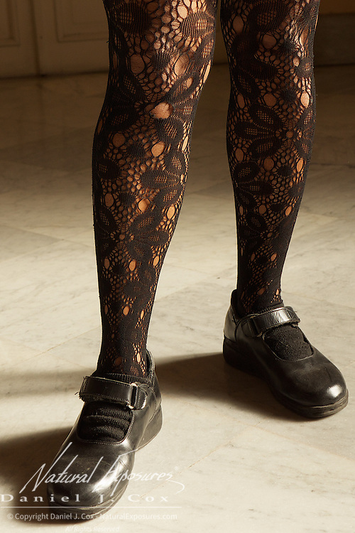 A woman in fancy, black, lace stocking which are currently very popular in Havana, Cuba.
