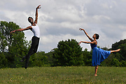 TIVOLI, NY - AUG 2:  Dancer Calvin Royal III, left, and  Courtney Lavine, right, practice social distancing as they dance in a field nearby the stage they will perform on at Kaatsbaan International Dance Center, Sunday, Aug. 2, 2020, in Tivoli, New York. (Photo by Jessica Hill for the Washington Post)