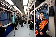 Hostess in shuttle train at Terminal Three of Beijing Capital International Airport, China