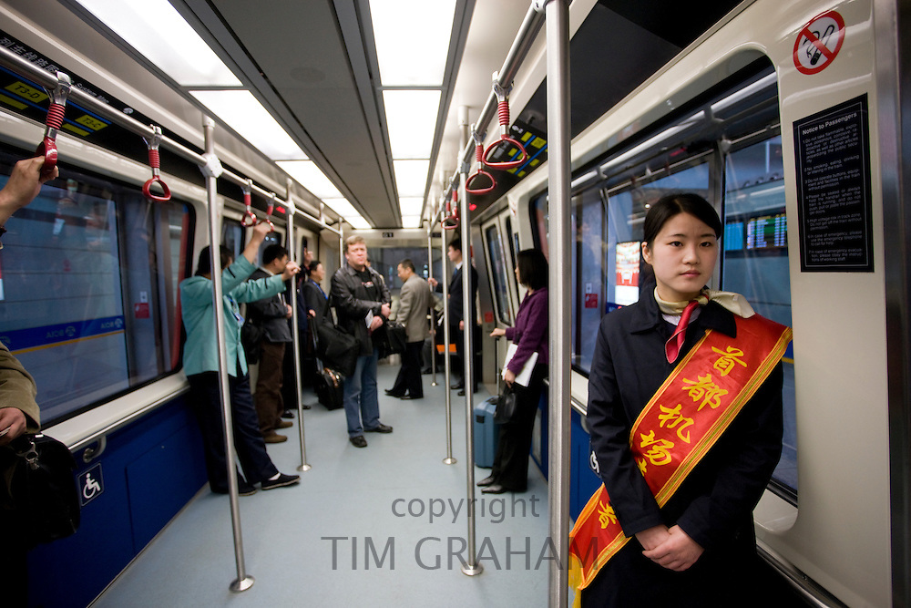 Hostess in shuttle train at Terminal Three of Beijing Capital International Airport, China
