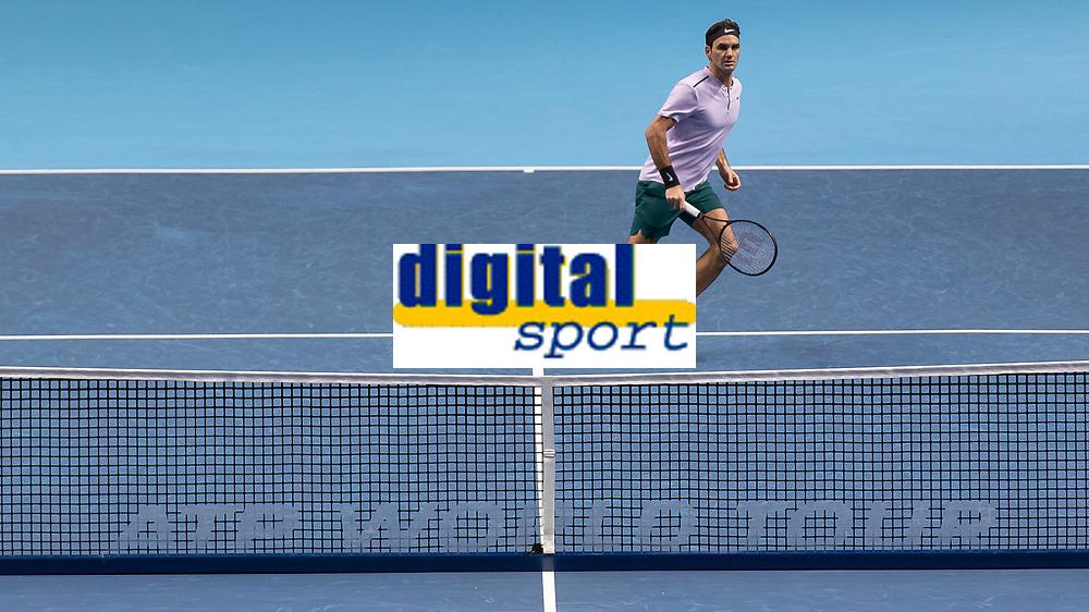 Tennis - 2017 Nitto ATP Finals at The O2 - Day Five<br /> <br /> Group Boris Becker Singles: Roger Federer (Switzerland) Vs Marin Cilic (Croatia)<br /> <br /> Roger Federer (Switzerland) comes to the ATP logo net <br /> at the O2 Arena<br /> <br /> COLORSPORT/DANIEL BEARHAM