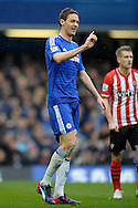 Nemanja Matic of Chelsea waving his finger to Referee Mike Dean. Barclays Premier league match, Chelsea v Southampton at Stamford Bridge in London on Sunday 15th March 2015.<br /> pic by John Patrick Fletcher, Andrew Orchard sports photography.