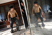 Robert, 25, (left) from Poland is fixing his room in the Ingram Avenue mansion while Lukats, 23, from Poland, (centre) is entering the room to check the progress being made, on Saturday, Sep. 22, 2007, in Hampstead, London, England. The 22-room mansion was last sold for UK£ 3.9M in 2002 and is now awaiting planning permissions to be demolished. Two new houses will soon be taking its place. Million Dollar Squatters is a documentary project in the lives of a peculiar group of squatters residing in three multi-million mansions in one of the classiest residential neighbourhoods of London, Hampstead Garden. The squatters' enthusiasm, their constant efforts to look after what has become their home, their ingenuity and adventurous spirit have all inspired me throughout the days and nights spent at their side. Between the fantasy world of exclusive Britain and the reality of squatting in London, I have been a witness to their unique story. While more than 100.000 properties in London still lay empty to this day, squatting provides a valid, and lawful alternative to paying Europe's most expensive rent prices, as well as offering the challenge of an adventurous lifestyle in the capital.