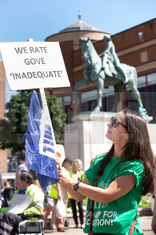 © Licensed to London News Pictures. 10/7/2014. Coventry, Warwickshire, UK. Hundreds of public sector workers held a demonstration in Coventry today. Speeches in Broadgate under the statue of Lady Godiva were followed by a march through the City Centre. Pictured, a local teacher voicing her opinion under the Lady Godiva statue in Broadgate. Photo credit : Dave Warren/LNP