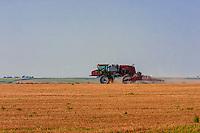 Tractor spraying fields, Schields & Sons Farm, near Goodland, Western Kansas USA.