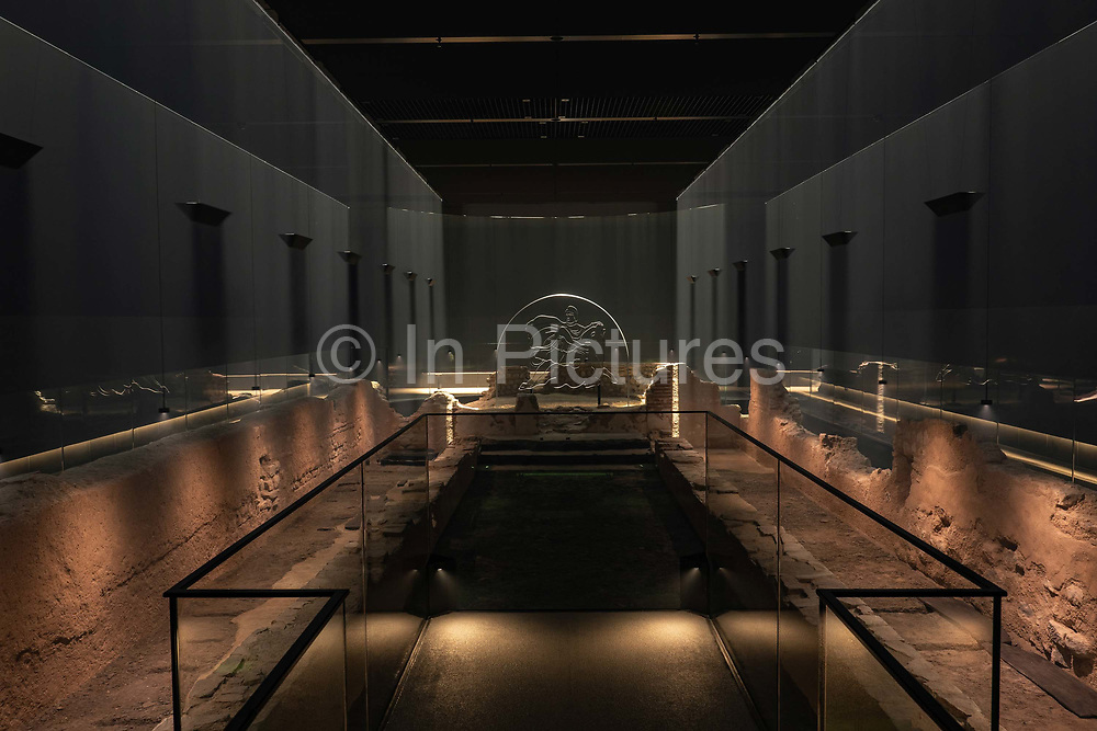 A reconstructed Roman temple using light and smoke machines, the Mithraeum, in the Bloomberg SPACE on the 24th September in London in the United Kingdom. The London Mithraeum, also known as the Temple of Mithras, Walbrook, is a Roman mithraeum that was discovered in Walbrook, a street in the City of London, during a buildings construction in 1954