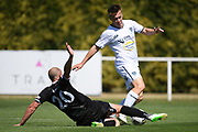 Hawke's Bay United's Bill Robertson slides in to tackle Auckland City FC's Jordan Vale in the Handa Premiership football match, Hawke's Bay United v Auckland City FC, Bluewater Stadium, Napier, Sunday, January 31, 2021. Copyright photo: Kerry Marshall / www.photosport.nz