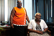 (L to R) Deneen Robinson and Marsha Jones pose for a photo at The Afiya Center on June 28, 2017 in Dallas, Texas. (Cooper Neill for The L.A. Times)