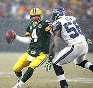 (2008)-Green Bay Packers' Brett Favre is stopped for no yards by Seattle Seahawks' LeRoy Hill in the first quarter. .The Green Bay Packers hosted the Seattle Seahawk in the NFC Divisional Playoffs Saturday January 12, 2008. Steve Apps-State Journal.
