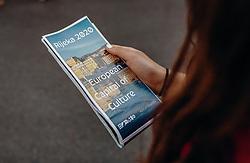 THEMENBILD - eine Frau hält eine Broschüre in den Händen, auf der steht, dass Rijeka 2020 europäische Kulturhauptstadt ist, aufgenommen am 14. August 2019 in Rijeka, Kroatien // a woman is holding a brochure which says that Rijeka 2020 is the European Capital of Culture, pictured in Rijeka, Croatia on 2019/08/14. EXPA Pictures © 2019, PhotoCredit: EXPA/Stefanie Oberhauser