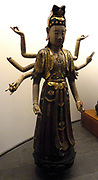Bodhisattva Avalokitesvara with eight arms. Avalokitesvara lord who looks down. A major Bodhisattva in Mahayana Buddhism. 18th century, Vietnamese sculpture in wood, gilt, lacquer and polychrome.