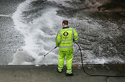 ©  London News Pictures 05/05/2011. Highways Agency clean-up crew wash the road surface of the Westbound Euston Underpass. The A501 Euston Road Underpass is closed westbound due to an traffic incident. 05/05/2011  Westbound traffic at Euston Underpass is being diverted via Gower Street causing heavy congestion around the surrounding roads. A white box van involved in the incident remains on the westbound lane of the Euston Underpass, both westbound entrance and exit ramps are covered with fuel or oil, the underpass remains closed. Photo Credit should read: Simon Lamrock/LNP