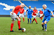 Tommy Charlton of England over 60's on the attack during the world's first Walking Football International match between England and Italy at the American Express Community Stadium, Brighton and Hove, England on 13 May 2018. Picture by Graham Hunt.
