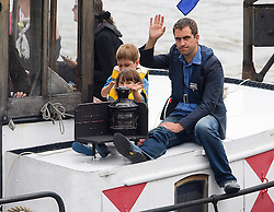 © Licensed to London News Pictures. 22/06/2016. London, UK.  A barge carrying BRENDAN COX with his children CUILLIN and LEJLA arrives in Westminster  for a memorial service to mark the life of the Labour MP for Batley and Spen Jo Cox, who would have turned 42 today.  Photo credit: Ben Cawthra/LNP