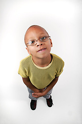 Wide angle shot of young boy standing looking upwards,