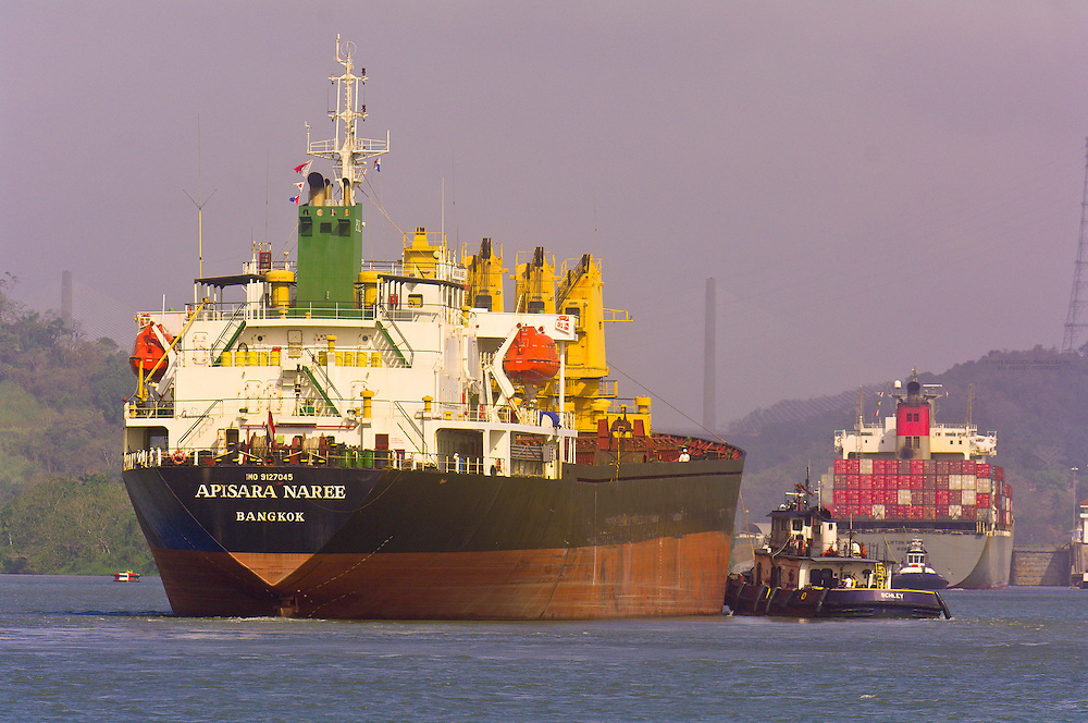 Tugboats escort a container ship as it leaves the Miraflores Locks on the Panama Canal, Panama