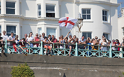 i© Licensed to London News Pictures. 07/07/2018. Brighton, UK. Football fans on the sea front in Brighton watch a giant TV screen on the beach showing England's 2-0 quarter-final win over Sweden at the Russian World Cup. Photo credit: Peter Macdiarmid/LNP