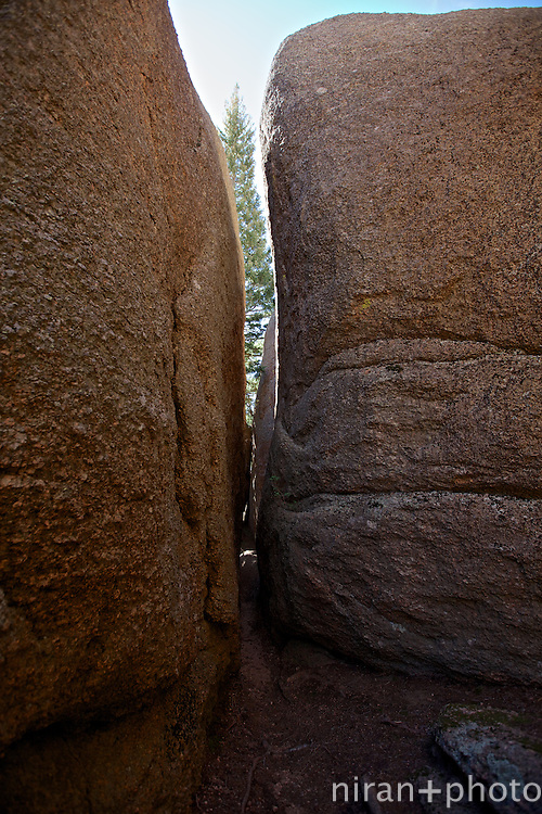 Narrow passage way through two massive boulders. For scale, these boulders are at least 20-25 feet tall.