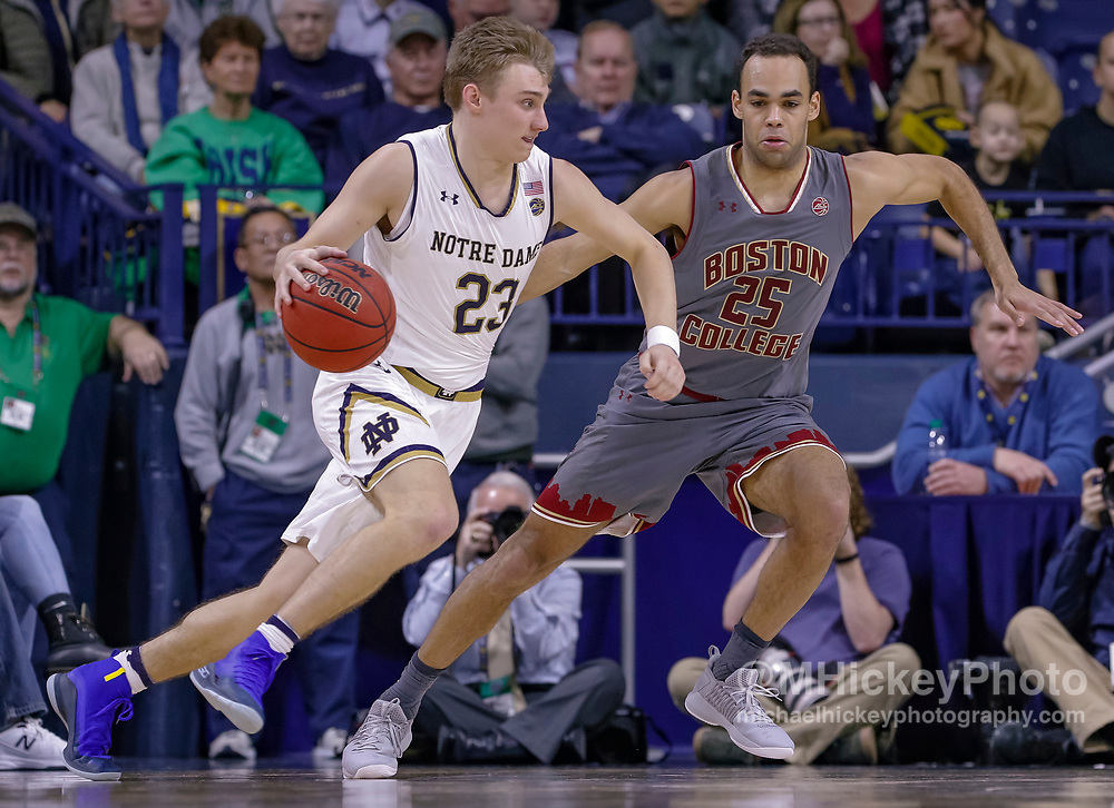 SOUTH BEND, IN - JANUARY 12: Dane Goodwin #23 of the Notre Dame Fighting Irish dribbles the ball against Jordan Chatman #25 of the Boston College Eagles at Purcell Pavilion on January 12, 2019 in South Bend, Indiana. (Photo by Michael Hickey/Getty Images) *** Local Caption *** Dane Goodwin; Jordan Chatman
