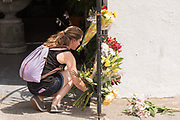 A women leaves flowers at the Mother Emanuel African Methodist Episcopal Church on the 2nd anniversary of the mass shooting June 17, 2017 in Charleston, South Carolina. Nine members of the historic African-American church were gunned down by a white supremacist during bible study on June 17, 2015.