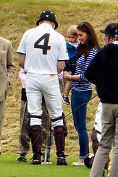 © Licensed to London News Pictures. 14/06/2015. PRINCE WILLIAM (left) talking to his son PRINCE GEORGE OF CAMBRIDGE and his wife CATHERINE DUCHESS OF CAMBRIDGE after playing polo. British Royals attend a charity Polo match in Tetbury,  Gloucestershire, UK. Photo credit: Ben Cawthra/LNP
