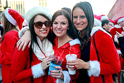 13 December 2014. New Orleans, Louisiana. <br /> L/R- Victoria Walters, Lindsey Fontaine and Madison at the 4th annual running of the Santas in downtown New Orleans. Proceeds from the event benefit 'That Others May Love' charity.<br /> Photo; Charlie Varley/varleypix.com