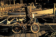 Image of bike and boats at the local marina in Rockport, Maine, American Northeast by Andrea Wells