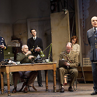 """The Lyceum present the World Premiere of Pressure<br /> By David Haig<br /> <br /> Picture shows :(l-r)<br /> Michael Mackenzie, Malcolm Sinclair, Scott Gilmour, Anthony Bowers, Laura Rogers and David Haig <br /> Malcolm Sinclair – General Dwight D """"Ike"""" Eisenhower ( at table)<br />  David Haig – Group Captain Dr. James Stagg (far right)<br /> <br /> <br /> Picture : Drew Farrell<br /> Tel : 07721 -735041<br /> www.drewfarrell.com<br /> Directed by John Dove<br /> A co-production with Chichester Festival Theatre<br /> June 1944. One man's decision is about to change the course of history.<br /> <br /> Cast<br /> David Haig – Group Captain Dr. James StaggLaura Rogers – Kay SummersbyRobert Jack – AndrewAnthony Bowers – Lieutenant Battersby/ Captain JohnsScott Gilmour – Young Naval RatingMalcolm Sinclair – General Dwight D """"Ike"""" EisenhowerTim Beckmann – Colonel Irving P. KrickMichael Mackenzie – Electrician/Admiral Bertram """"Bertie"""" RamsayAlister Cameron – Air Chief Marshall Sir Trafford Leigh-MalloryGilly Gilchrist – General """"Tooey"""" Spaatz/Commander Franklin<br /> Creative Team<br /> Director - John DoveDesigner - Colin RichmondLX Designer - Tim MitchellDeputy LX Designer - Guy JonesComposer/Sound Design - Philip PinskyVideo Designer - Andrzej Goulding<br /> An intense real-life thriller centred around the most important weather forecast in the history of warfare.Scottish meteorologist, Group Captain James Stagg, the son of a Dalkeith plumber, must advise General Eisenhower on when to give the order to send thousands of waiting troops across the Channel in Operation Overlord.In what became the most volatile period in the British Isles for over 100 years, the future of Britain, Europe and our relationship with the United States, rested on the shoulders of one reluctant Scotsman.<br /> Pressure is the extraordinary and little known story of a Scot who changed the course of war, and our lives, forever.David Haig is a four time nominee and Olivier Award winning actor best """