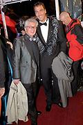 Ambilight Opening Night 'See You in Vegas' in Tuschinski, Amsterdam . De premiere van de documentaire over illusionist Hans Kok zijn avontuur in Vegas.<br /> <br /> Op de foto:<br /> <br />  Jacques d'Ancona en partner Hans Langhout