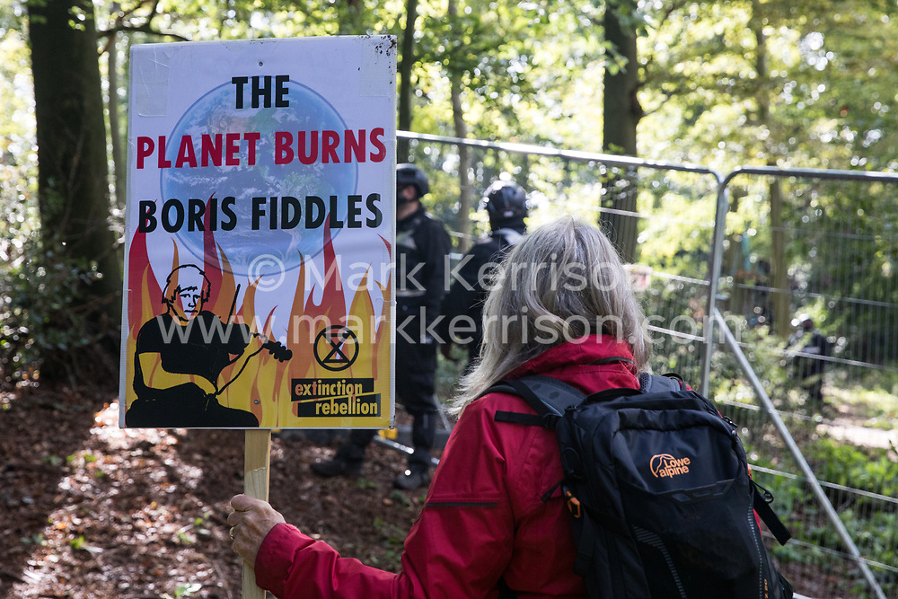 Anti-HS2 activists and local residents observe National Eviction Team bailiffs working on behalf of HS2 Ltd during evictions from a wildlife protection camp in the ancient woodland which inspired Roald Dahl's Fantastic Mr Fox at Jones' Hill Wood on 1 October 2020 in Aylesbury Vale, United Kingdom. Around 40 environmental activists and local residents, some of whom living in makeshift tree houses 60 feet above the ground, were present during the evictions at Jones' Hill Wood which had served as one of several protest camps set up along the route of the £106bn HS2 high-speed rail link in order to resist the controversial infrastructure project.