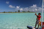 child on boat, Christmas ( Kiritimati ) Island, Line Islands, Kiribati ( Central Pacific ) MR 300