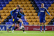 AFC Wimbledon midfielder Jack Rudoni (12) dribbling during the EFL Sky Bet League 1 match between AFC Wimbledon and Lincoln City at Plough Lane, London, United Kingdom on 2 January 2021.
