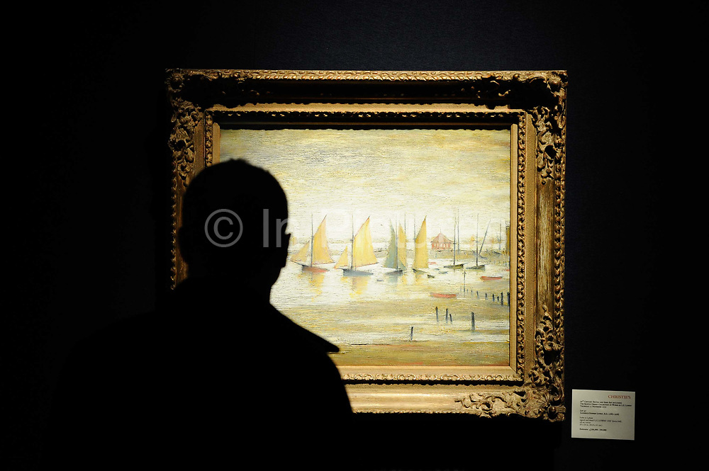 A man looks at 'Yachts at Lytham', a painting by British artist L.S. Lowry which along with twenty other works by the artist will be auctioned at Christie's on November 11.The painting has an estimated value of between 250,000 and 350,000 pounds, London.