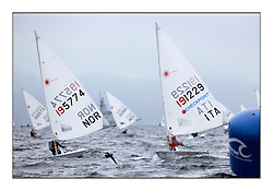 The second day of racing at the World Laser Radial Youth Championships, Largs, Scotland...Hermann Tomasgaard NOR 195774 and Luca Antognoli ITA 191229..317 Youth Sailors from 42 different nations compete in the World and European Laser Radial Youth Champiponship from the 17-25 July 2010...The Laser Radial World Championships take place every year. This is the first time they have been held in Scotland and are part of the initiaitve to bring key world class events to Britain in the lead up to the 2012 Olympic Games. ..The Laser is the world's most popular singlehanded sailing dinghy and is sailed and raced worldwide. ..Further media information from .laserworlds@gmail.com.event press officer mobile +44 7866 571932 and +44 1475 675129 .