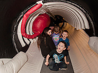 Aiden Vintenner notices the whale's blowhole during a visit inside the belly of a whale during Abby Gronbert's presentation with Blue Ocean Society for Marine Conservation's on Sunday afternoon at the Leavitt Park Clubhouse.   (Karen Bobotas/for the Laconia Daily Sun)